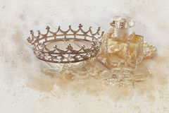Watercolor style and abstract illustration of vintage perfume bo. Ttle and diamond tiara stock image