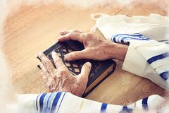 Watercolor style and abstract image of Old Jewish man hands holding a Prayer book. Jewish traditional symbols. Watercolor style and abstract image of Old Jewish stock image