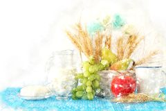 watercolor style illustration of dairy products and fruits over wooden background. Symbols of jewish holiday - Shavuot. Royalty Free Stock Photo