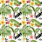 Watercolor tropical leaves seamless pattern. Hand painted palm leaf, exotic plumeria flowers and green foliage on white background. Watercolor summer seamless stock photos