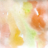Watercolor texture transparent yellow orange pink shades spots. Watercolor abstract background, spot, blur, fill Royalty Free Stock Photography