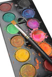 Watercolor tray. Close-up view of watercolor palette with multiple colors and brush Royalty Free Stock Photo