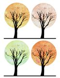 Watercolor trees. Four stylized watercolor trees with black branches Royalty Free Stock Photography
