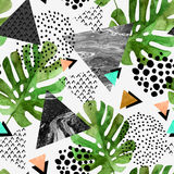 Watercolor tropical leaves and textured triangles background Stock Photography