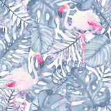 Watercolor tropical seamless pattern hand painted pink flamingo and leaves of indigo palm monstera. Isolated on white background. Floral illustration. Botanical Royalty Free Stock Image