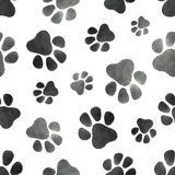Watercolor vector seamless pattern with the imprint of dog paws. Watercolor seamless pattern with the imprint of dog paws. Black and white vector illustration Stock Photo