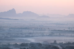 Watercolor view of foggy morning landscape. Hpa An, Myanmar (Bur Royalty Free Stock Photo
