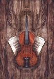 Watercolor vintage violin fiddle musical instrument with music notes on wooden texture background.  Royalty Free Stock Image