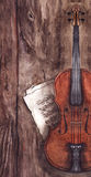 Watercolor vintage violin fiddle musical instrument with music notes on wooden texture background.  Stock Photography