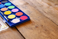 Watercolor on wooden desk. selective focus Royalty Free Stock Image