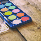 Watercolor on wooden desk. selective focus Stock Photo
