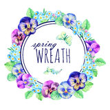 Watercolor wreath of pansies and forget-me-not. Stock Image