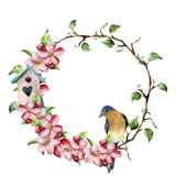 Watercolor wreath with tree branches, apple blossom, bird and birdhouse. Hand painted floral illustration isolated on