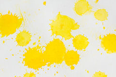 Watercolor yellow splashes abstract. Watercolor rich yellow abstract background. Hand made splashes on grainy paper Stock Photos