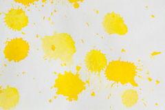 Watercolor yellow splashes abstract. Watercolor rich yellow abstract background. Hand made splashes on grainy paper Stock Images