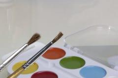 Watercolors και βούρτσες για τη ζωγραφική Στοκ Εικόνα