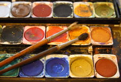 Watercolors. Old, dry watercolors with brush Royalty Free Stock Images