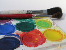 Watercolors. Watercolor paints and brushes closeup Royalty Free Stock Images