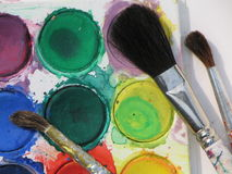 Watercolors. Watercolor paints and brushes closeup Stock Photo
