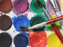 Watercolors. Watercolor paints and brushes closeup Stock Image