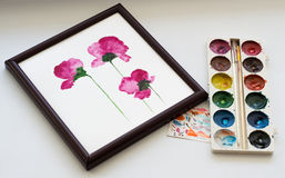 Watercolors, brush and painting of beautiful pink flowers in frame on white background, artistic workplace Stock Image