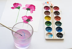 Watercolors, brush and painting of beautiful pink flowers on white background, artistic workplace Royalty Free Stock Photo