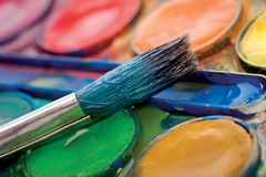 Watercolors and brush. royalty free stock images