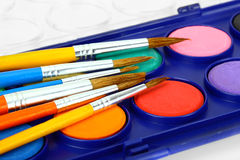 Watercolors and brushes. Watercolor and brush on a white background Royalty Free Stock Images