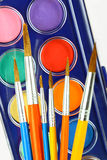 Watercolors and brushes. Watercolor and brush on a white background Royalty Free Stock Photos