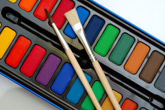Watercolors and brushes. Box of watercolors and two brushes - painting concept Stock Photo