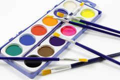 Watercolors and brushes Stock Photography