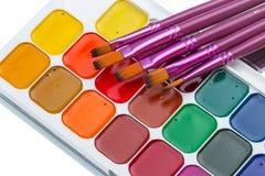 Watercolors and brushes closeup Royalty Free Stock Photos