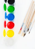 Watercolors and brushes. Gouache paints and watercolors with paintbrushes Royalty Free Stock Photo