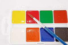 Watercolors and brushes isolated Stock Image