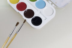 Watercolors and brushes for painting Royalty Free Stock Photo