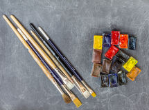 Watercolors and brushes. Watercolor cubes and paintbrushes Stock Photo