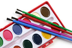 Watercolors and brushes wide. Watercolors and brushes isolated on a white background Stock Photography
