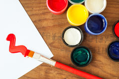 Watercolors and brushes on wooden background Stock Photo