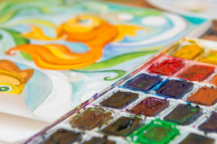 Watercolors and a fragment of the picture goldfish Royalty Free Stock Photo