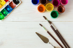 Watercolors and paint brush on white wooden background Royalty Free Stock Photography