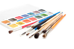 Watercolors with paint brushes. Royalty Free Stock Photo