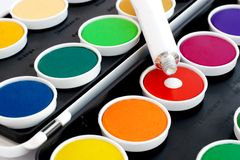 Watercolors with white tube Royalty Free Stock Images