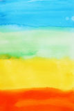 Watercolour background. With 4 colours, blue, green, yellow and red Stock Image