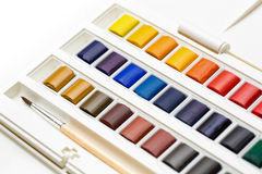 Watercolour and brush closeup Royalty Free Stock Photography