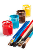 Watercolour pain in jars and paint brushes Stock Images