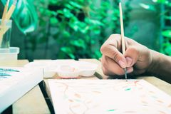 Watercolour painting with brush, Hobby, Close up happiness lifest. Yle, Painting on paper royalty free stock photo