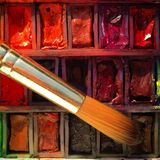 Watercolour paints and brush close up Royalty Free Stock Photos