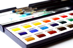 Watercolour paints and brushes Stock Photo
