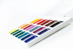 Watercolour paints on a white background Royalty Free Stock Image