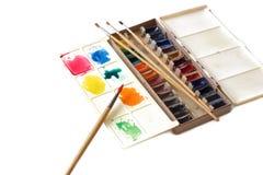 Watercolour whith paintbrushes Stock Photos